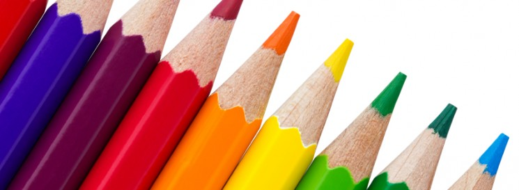 Row of colourful pencils isolated over white background